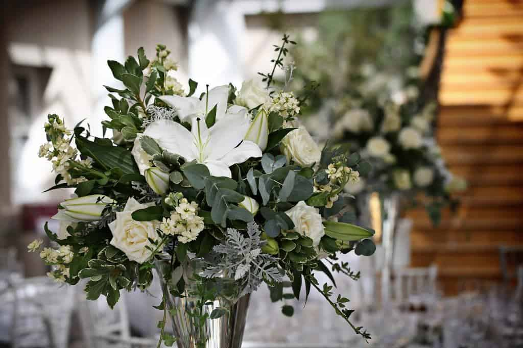 Vase filled with white flowers and silver foliage