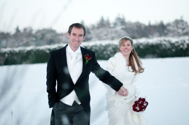 Snowy winter wedding with bride and groom
