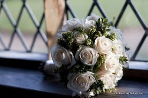 brides bouquet of roses winter hebe and diamante pins