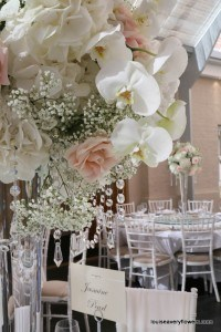 tall table arrangement including white hydrangea, white orchids, gypsophlia and crystal drops