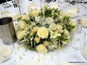 Romantic wedding flowers. Ring of cream and white flowers including ivory roses
