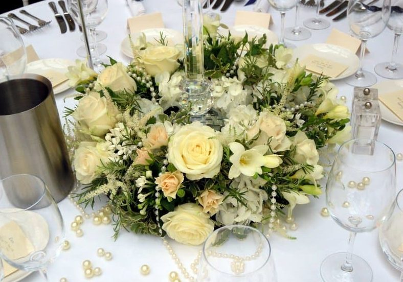 Hampshire weddings, cain Manor , Ring of cream and white flowers including ivory roses