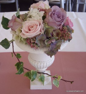 Romantice wedding flowers Small ivory table urn filled with vintage pink & mauve shade roses