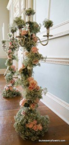 Romantic wedding flowers. 6ft floor standing candelabra, garlanded with pink roses and gypsophlia