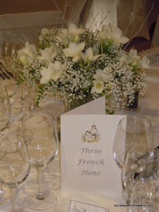 winter white table arr of freesia & gypsophlia , winter wedding