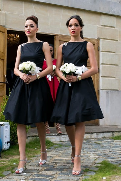 bridesmaids with white rose bouquets