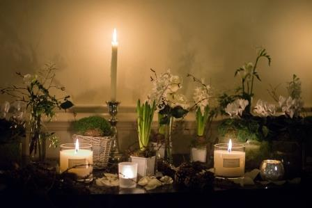 Winter styling with white plants, candles and flower vases
