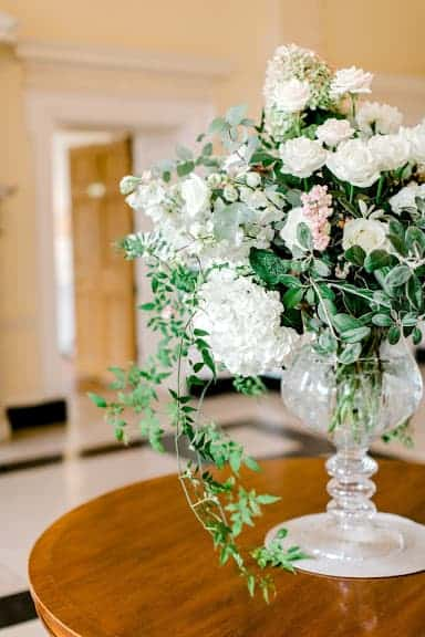 Glass urn of white summer flowers by Louise Avery flowers