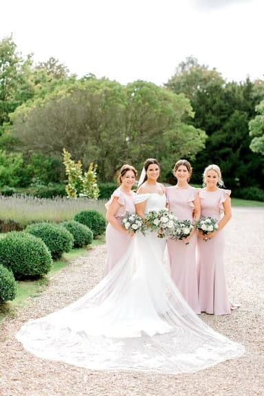 Bride and bridesmaids holding their bouquets, by Louise Avery Flowers