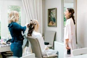 wedding morning bride with hairdresser
