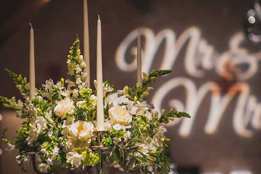 wedding table candelabraflower decoration with Mr & Mrs wall sign
