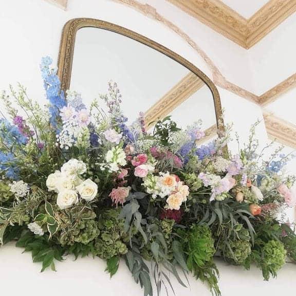 English Country Garden Flowers in mantel shelf arrangement