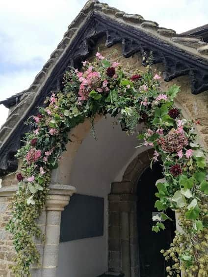 Full church doorway floral arch