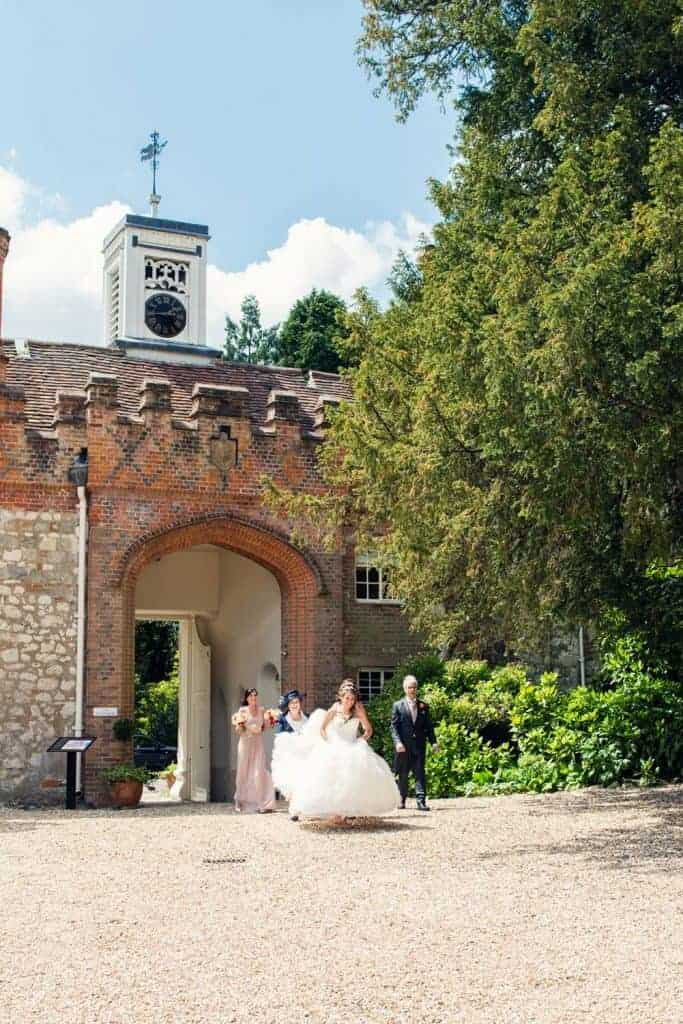 The gate House at Farnham Castle with bride