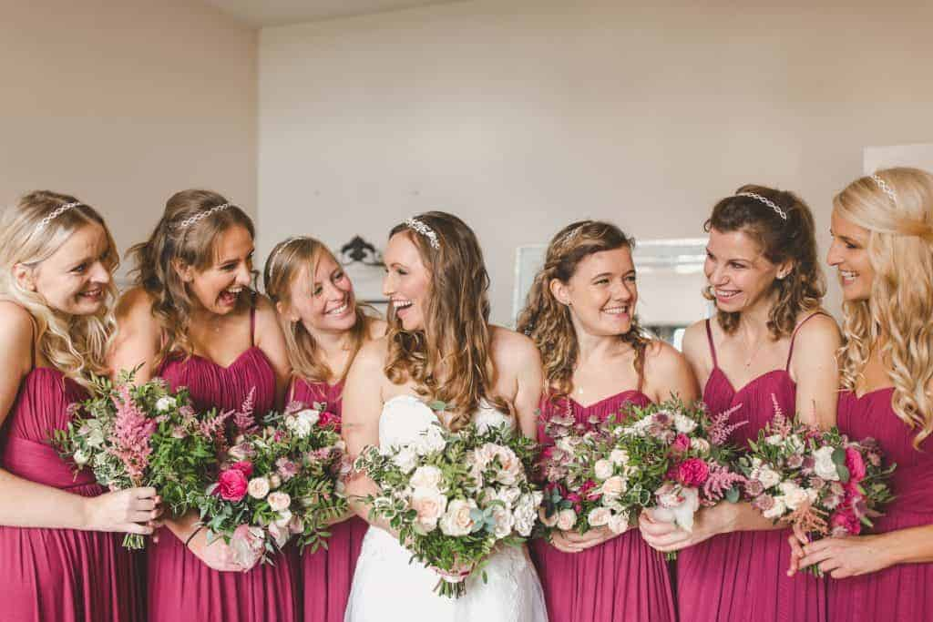 bridesmaids with bride holding their bouquets