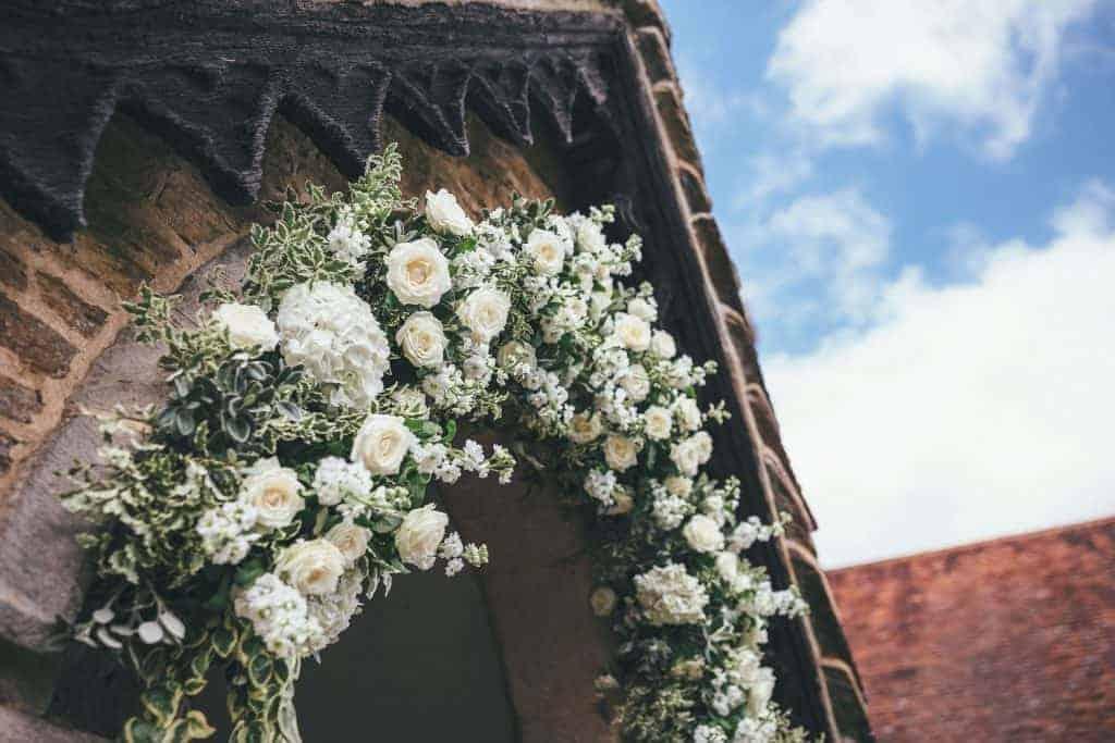 Church crescent shape floral arch