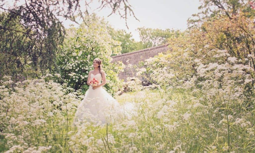 Farnham Castle Weddings.Bride in Castle grounds