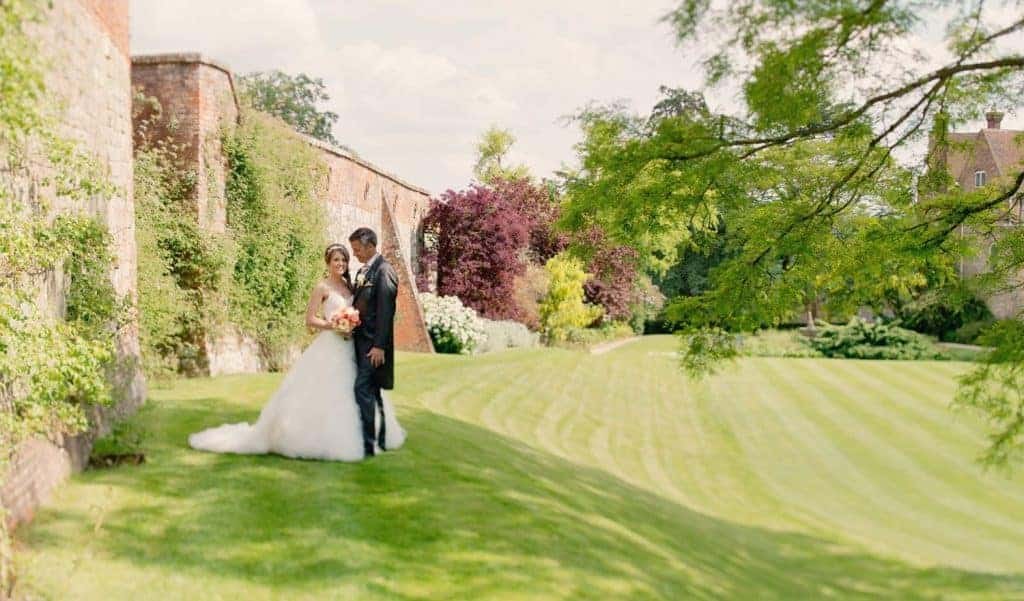 Farnham Castle Weddings. Bride and groom in castle grounds