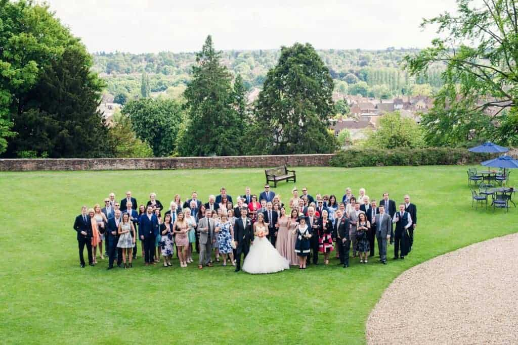 Stunning Surrey views with the bridal party on the lawn