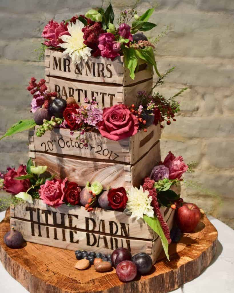 Luxury hampshire wedding. Tartufi Wedding cake decorated with Autumn flowers supplied by Louise Avery Flowers