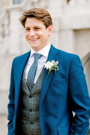Groom wearing his buttonhole