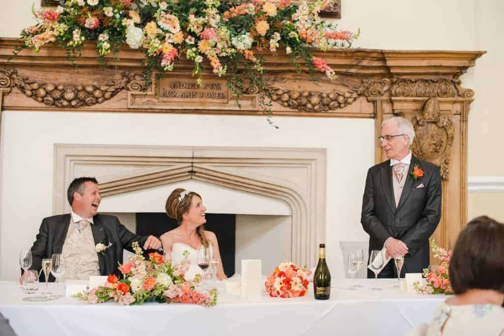 Top table and Fireplace mantle-shelf flower arrangement in the Great Hall of Farnham Castle