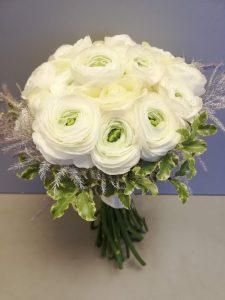 Springtime flowers for an April wedding - White ranunculus brides bouquet