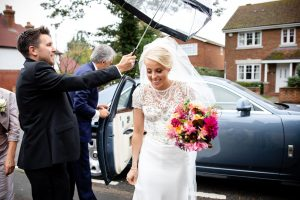 Bride-holding-her-bouquet-arriving-at-the-church